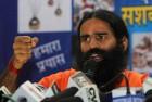 Ramdev addresses media during his visit in New Delhi.