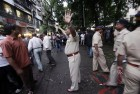 <b>No go</b> Mumbai police tries to control the crowd at Dadar