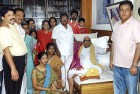 <b>Driven to the wall</b> Karunanidhi with his family members and the Maran brothers