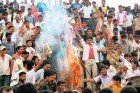 Agitating UP farmers burn a Mayawati effigy