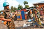 <b>Bad Burden</b>  File photo of an Indian soldier on UN duty at a  market in Goma, N. Kiva, Congo, in October 2005