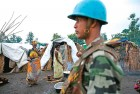 An UN peacekeeper from India patrols a refugee camp in Rutshuru, Eastern Congo