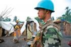 An UN peacekeeper from India patrols a refugee camp in Rutshuru, Eastern Congo