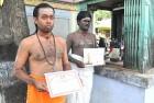 V. Ranganathan (left) and K. Venkadesan with their certificates