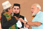<b>Sadbhavana undone</b> Modi refusing to wear a skullcap offered by the Imam Shahi Saiyad of Prara