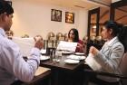 <b>Pretty please</b> Kauser Khan, at a table manners class