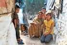 <b>Happy today</b> A migrant family at a New Delhi slum