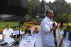 <b>Watery Fears</b> Kerala MPs protest outside Parliament as A.K. Antony walks by