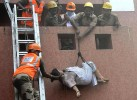 <b>A Life Saved</b> Rescue workers evacuate a patient from AMRI