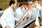 President Mohd Ahmadinejad, second from left, examines Iran's first domestically produced nuclear fuel rod, Tehran, Feb 15