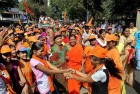Shiv Sena women workers celebrate their party's victory in the corporation elections in Thane, Mumbai.