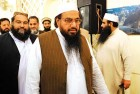 <b>Open air occasion</b> Hafiz Saeed arrives for his press conference in Rawalpindi on April 4
