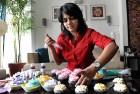 Bayiravi Mani frosts her cupcakes