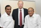 <b>Polite smiles?</b> Mukesh Ambani, BP CEO Robert Dudley and Union petroleum minister Jaipal Reddy