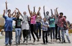 Students celebrate their success in CBSE XII examinations after the declaration of results in Bhopal.