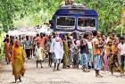Members of the Bangla-speaking Muslim community flee their village in Kokrajhar