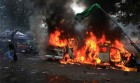 Vehicles in flames near CST Station after a protest against Assam riots turned violent in Mumbai
