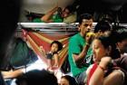 <b>Escape route</b> Fleeing northeasterners aboard a Guwahati train
