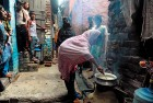 <b>Food for thought</b> A woman cooks in Jahangirpuri, Delhi