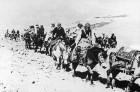 <b>Flight</b> The Dalai Lama flees across the Himalayas to India in 1959