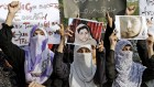 Members of Minhaj-ul-Quran Women League, Pakistan hold up pictures of 14-year-old schoolgirl Malala Yousufzai