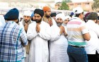 <b>After the end</b> The grieving Chadha clan before the brothers' last rites
