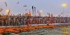 Naga sadhus of the fiery Juna akhara get ready for the Shahi snan on Makar Sankranti day at the Sangam, Allahabad, Jan 14