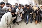 <b>Mourning/celebrating Afzal</b> Kashmiris raise slogans outside Afzal's house in Seer Jagir, near Sopore