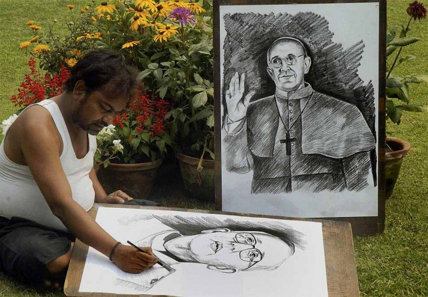 Outlook photogallery pavement artist ramzan hussain gives final touches on the pencil sketch of new pope francis in kolkata