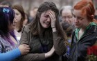 Emma MacDonald, 21, center, cries during a vigil for the victims of the Boston Marathon explosions at Boston Common