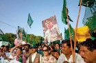 The shadow PML(Q) supporters hold aloft pictures of Gen Kayani