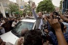 <b>Wave factor</b> Nawaz Sharif waves to supporters in Lahore after his victory