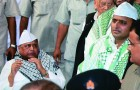 <b>More Muslim than thou</b> Mulayam and Akhilesh at an iftar party in Lucknow