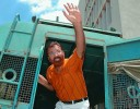 Vanzara waves to supporters at one of his court appearances