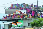 <b>Prince-watching</b> A rooftop audience for Rahul Gandhi in Rahatgarh
