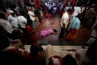 <b>Episodic</b> Some of the women patients faint after the exertions of an hour-long prayer session at the Ganagapur temple