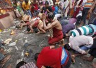 <b>For Shiva</b> Sadhus and devotees offer prayers during the festival of Gajan in Calcutta
