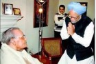 Prime Minister Manmohan Singh greets veteran BJP leader and former prime minister Atal Bihari Vajpayee on his 89th birthday