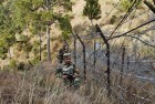 In this Dec. 23, 2013 photo, Indian army soldiers patrol near one of their forward post at the Line of Control (LOC), that divides Kashmir between India and Pakistan, at Krishna Ghati (KG Sector) in Poonch.