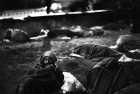 The ISBT: Bodies huddle up under a flyover near the bus terminal