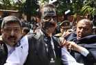 March 4, 2014: Ink is thrown on the face of the Chairman of Sahara India Pariwar Subrata Roy as he walks into the Supreme Court