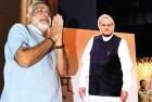 <b>Two faces</b> Modi with a cutout of Vajpayee in the background at a BJP meeting