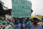 Women attend a demonstration calling on  government to rescue kidnapped school girls of a government secondary school Chibok, during workers day celebration in Lagos, Nigeria.