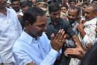 Telangana Rashtriya Samithi President K. Chandershekar Rao greets his supporters after casting his vote for the Lok sabha elections in Siddipet.
