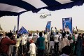 <b>Come, sister</b> BSP supporters wave at a chopper carrying Mayawati at a rally in Allahabad