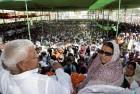 <b>Seat Taken?</b> Laloo and wife Rabri Devi, the RJD's Saran candidate, at a Chhapra rally