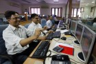File photo: Stock traders exult as the markets scale newer peaks