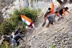 BJP activists cross the Ravi river during the 'Rashtriya ekta yatra', 2011