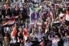 Supporters of Egypt's former military chief Abdel-Fattah el-Sissi celebrate Tuesday's official announcement declaring him the next president of Egypt in front of the Presidential Palace in Cairo, Egypt. Arabic reads,