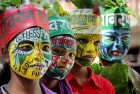 Girls paint their faces with messages on environmental awareness in a program on the occasion of World Environment Day, in Allahabad.